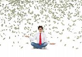 Man Catching Falling Dollar Bills