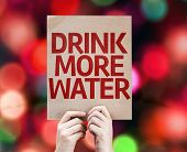 Drink More Water card with colorful background with defocused lights