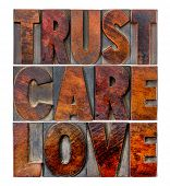 trust, care, love - an isolated word abstract in vintage letterpress wood type