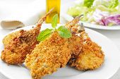 stock photo of hake  - closeup of a plate with some breaded and fried hakes - JPG