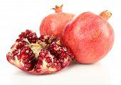 Juicy ripe pomegranates, isolated on white