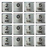 New year 2015 is coming.  Silver phone buttons forming 2015 four time in a row.