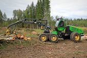 John Deere 1270E Wheeled Harvester In Forest