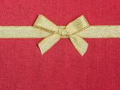 Golden Bow On Red Silk
