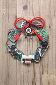 picture of christmas wreath  - geeky christmas wreath made by old computer parts hanging on wooden door - JPG
