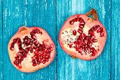 Fresh pomegranate on blue wood