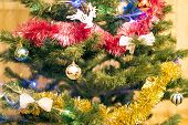 Christmas Tree With Different Toys, Decorations And Garlands