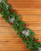Garland With Christmas Ornaments And Pine Cones On Wooden Background.