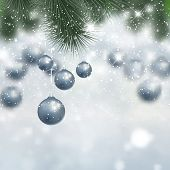 Decorative Christmas background with hanging silver baubles