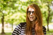 Portrait of happy beautiful young woman wearing sunglasses