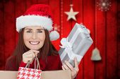 Woman with gifts against blurred christmas background