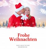 festive couple against christmas greeting in german
