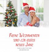 Happy couple at christmas against frohe weihnachten message