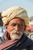 Old Cattle Farmer With Yellow Turban.