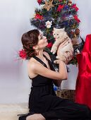 beautiful happy young woman in evening dress with fluffy kitten