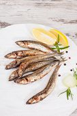 Grilled Sardines On Wooden Background.
