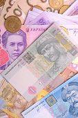 Постер, плакат: Pile Of Ukrainian Money Isolated On White