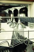 stock photo of dishwasher  - details of Open dishwasher with clean utensils - JPG
