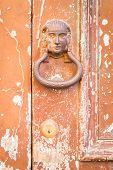 foto of door-handle  - The old door handle on the old cracked door - JPG