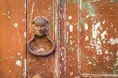 picture of door-handle  - The old door handle on the old cracked door - JPG