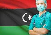 stock photo of libya  - Surgeon with national flag on background  - JPG