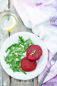 stock photo of quinoa  - chickpeas quinoa and beet burgers with arugula on a white wood background - JPG