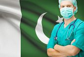 pic of pakistani flag  - Surgeon with national flag on background  - JPG
