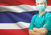 picture of surgeons  - Surgeon with national flag on background  - JPG