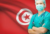 stock photo of surgeons  - Surgeon with national flag on background  - JPG
