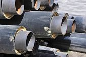 pic of insulator  - Steel pipe with heat insulation on construction site - JPG