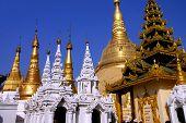 stock photo of yangon  - Golden spires of stupas surrounding the Shwedagon Pagoda Yangon  - JPG