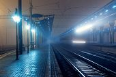 foto of passenger train  - High speed passenger train on tracks with motion blur effect at night - JPG