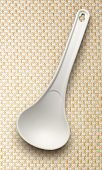 image of ladle  - White plastic ladle on the cloth background - JPG