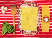 picture of lasagna  - Making of tasty Italian lasagna on a bright background - JPG