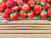 stock photo of bamboo  - Fresh strawberry on bamboo wood panel in the garden - JPG