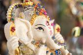 stock photo of ganesh  - Ganesh elephant god figure closeup focused on face - JPG