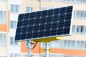 foto of solar battery  - a Street lamp powered by solar batteries - JPG