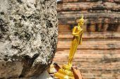 pic of tilt  - Small tilt buddha in temple of country  - JPG