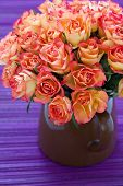 foto of purple rose  - many beautiful fresh roses on a purple table - JPG