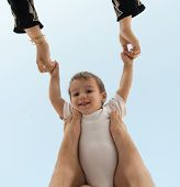 picture of legs air  - Arabic woman holding baby in air and playing - JPG
