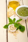 stock photo of pesto sauce  - Italian traditional basil pesto sauce ingredients on a rustic table - JPG