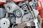 stock photo of scrap-iron  - Scrap metal old car parts in a garage - JPG