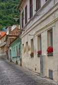 picture of cobblestone  - Cobblestone street with old buildings in Transylvania.