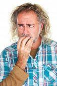 foto of fingernail  - Single isolated man in beard biting fingernails - JPG