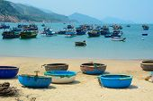 picture of coracle  - Picturesque sea landscape with tribal boats on beautiful beach - JPG
