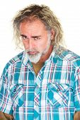 foto of sulky  - Brooding mature male with depressed expression over white - JPG