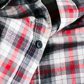 picture of button down shirt  - Close up detail of a red plaid button up style shirt - JPG
