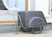 pic of peddlers  - old cart on wheels for storage and transportation of ice cream built Ice cream - JPG