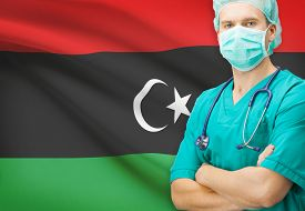 picture of libya  - Surgeon with national flag on background  - JPG