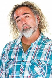 stock photo of snob  - Handsome mature man with beard and long hair - JPG